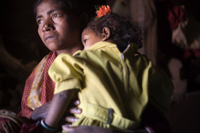 Widow Kadu Dei and her child, Harni Majhi, 2. Dei's husband was an anti- Vedanta Alumina activist who it is alleged, was killed in a hit and run accident by a car used by Vedanta employees. Dei is now forced to rely on the charity of her neighbours to survive. Kansari village, Orissa