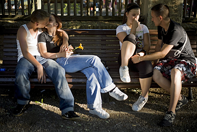 Hungary - Pecs - Teenage lovers embrace and kiss on a park bench