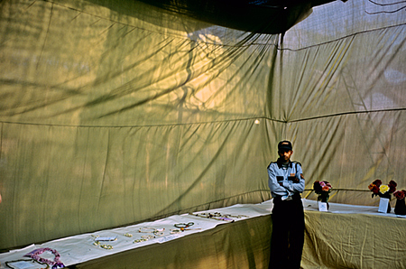India - New Delhi - A guard in a judging tent at a particularly Raj style event, The Delhi Flower show