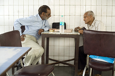India - New Delhi - Regular customers sit and talk in the Indian Coffee House, Baba Kharak Singh Marg
