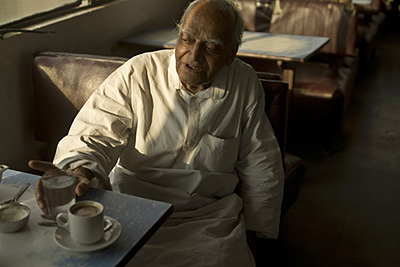 India - New Delhi - An elderly man in the Indian Coffee House, Baba Kharak Singh Marg