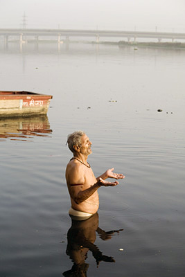 India - Delhi - A man ritually bathes in the Yamuna River at dawn
