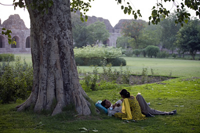 India - New Delhi - A couple in the grounds of the Purana Qila, New Delhi, India. Such parks are often the only place where young lovers can meet away from their parents and families