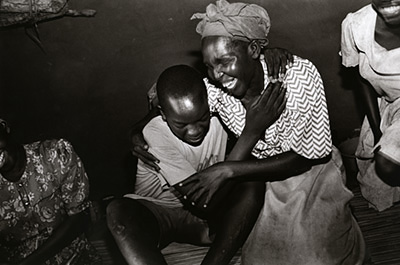Uganda - Gulu - A young man with obvious trauma is reunited with his mother and sisters after almost two years in the bush fighting with the Lords Resistance Army