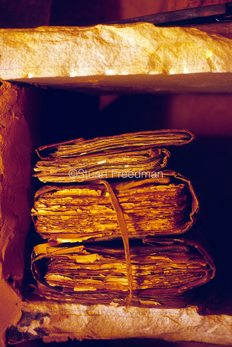 Mauritania - Chinguetti - A pile of priceless manuscripts in a desert library