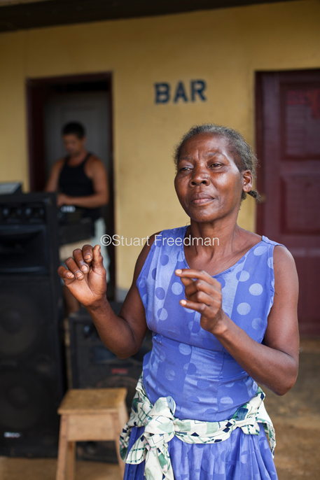 Sao Tome and Principe - Airport - Paula, a local woman dances at the White House bar near the airport, Sao Tome and Principe