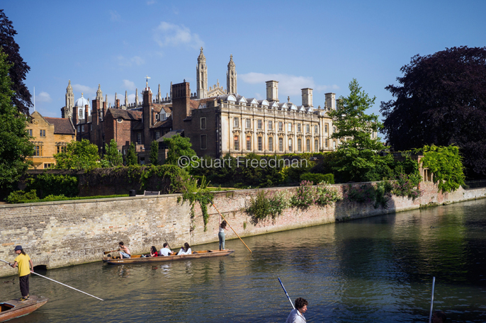 UK - Cambridge - Punts and passengers glide past The Clare College (founded 1326) on the River Cam past the Garret Hostel bridge, Cambridge, UK