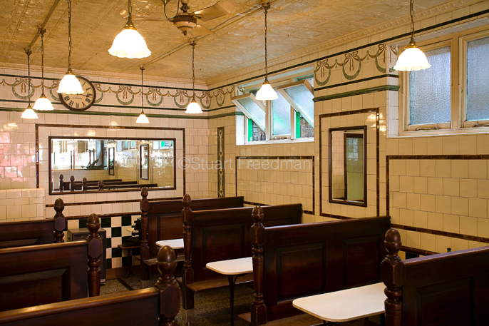 UK - London - The interior (including the painted tin tiles on the ceiling) of Manze's Eel, Pie and Mash shop in Walthamstow,