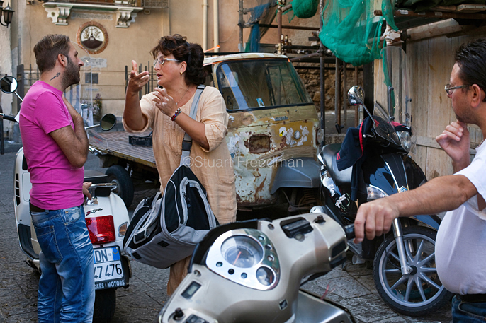 Italy - Palermo - A man and a woman in a heated conversation in a lane behind the Capo Market
