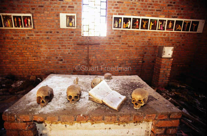 Rwanda - Ndera - Skulls on the alter of the church at Ndera, Rwanda that is now a national monument to those who were murdered inside by Hutu militias during the 1994 genocide