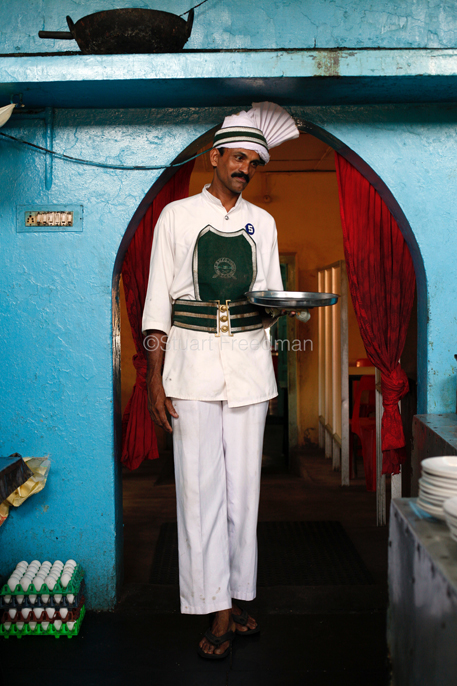 India - Kollom - A waiter in the Indian Coffee House