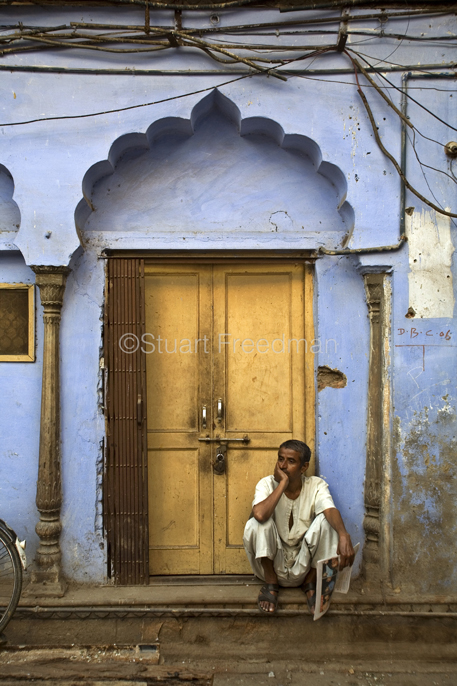 India - Delhi - A man lounges inside the remains of the Sultan Singh Ghar ki Haveli. Much of Old Delhi's historical architecture is being lost to new development. Old Delhi, India
