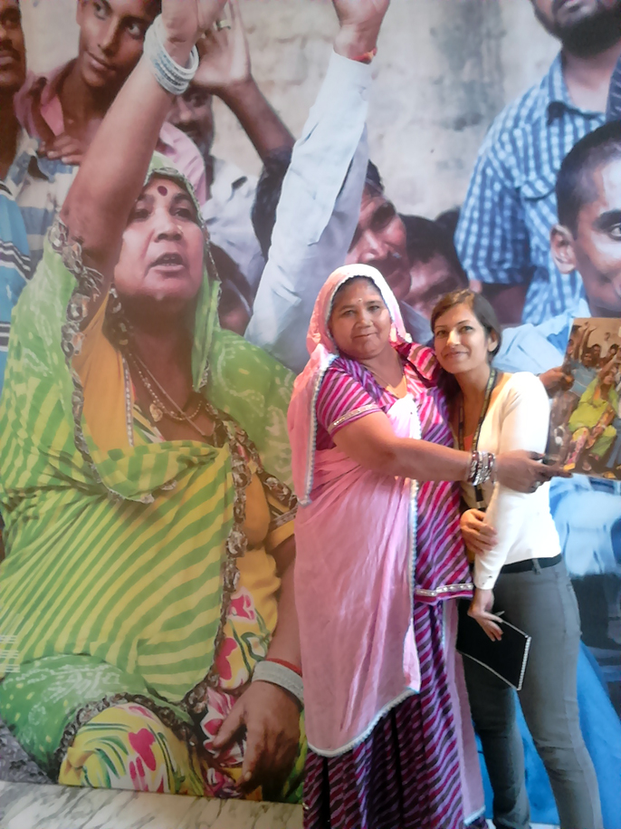India - New Delhi - Sarbati Das from Kathputli Colony (in front of her cover image used as a poster at the LSE Cities Conference) and the excellent Sunayana Wadhawan