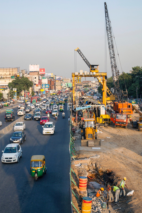 India - New Delhi - Traffic and Metro construction work at South Extension Market