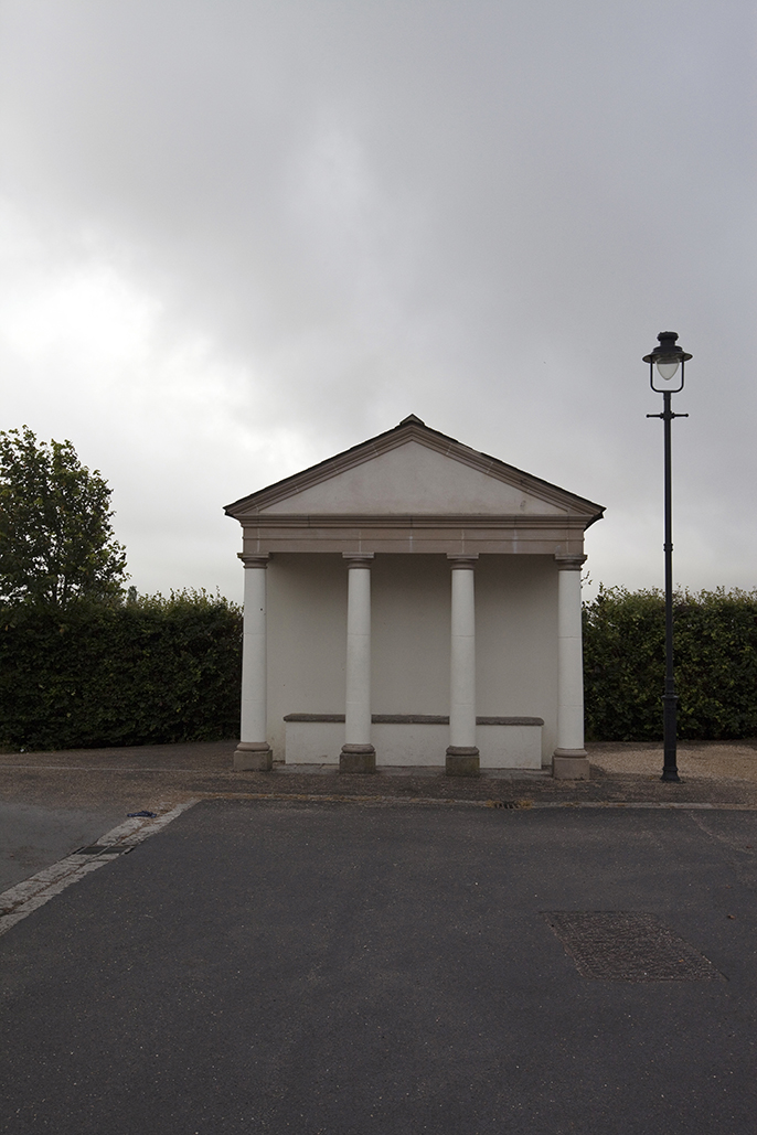 A traditionally styled shelter in Poundbury. Poundbury on Duchy of Cornwall land is Prince Charles' attempt to create an urban extension to Dorchester famed for Its pastiche of traditional architecture. Dorset, UK