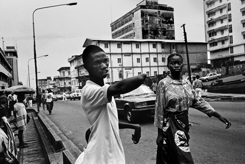 Hassan Fofona begs outside the Post office
