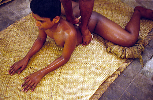 A boy is massaged by his teacher at the Kalamandalam. Massage is seen as an essential part of Katahakali practice making the body supple.