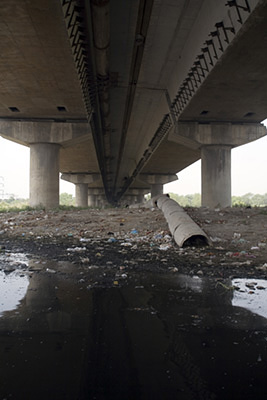 India - Delhi - A sewer pipe flowing straight into the Yamuna by the Kudsia Ghat, New Delhi, India