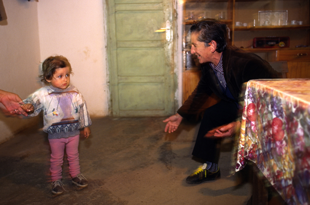 Albania - Thethi - Pashke Sokol Ndocaj with a  neighbours child. Since the death of her father and brothers, Pashke has lived as a man in the ancient traditions of Avowed Virgins of Albania, where women 'become' men to head the family and renounce their former sex