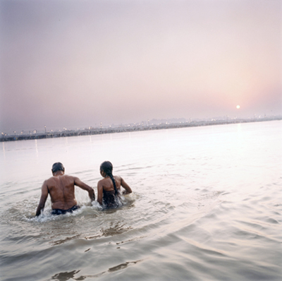India - Allahabad - A pilgrim and his wife get ready to immerse themselves in the Ganges as an act of religious purification