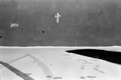 Lebanon - B'charre - A crucifix painted on a wall in the snow in Khalil Gibran's birthplace, B'charre, Northern Lebanon. The area is occupied by Syrian troops and so the indigenous population paint crucifixes as a symbol of opposition