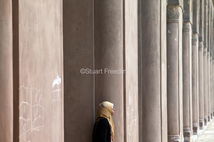 Egypt - Cairo - A young woman wearing a headscarf in the courtyard of the Ibn Tulun Mosque