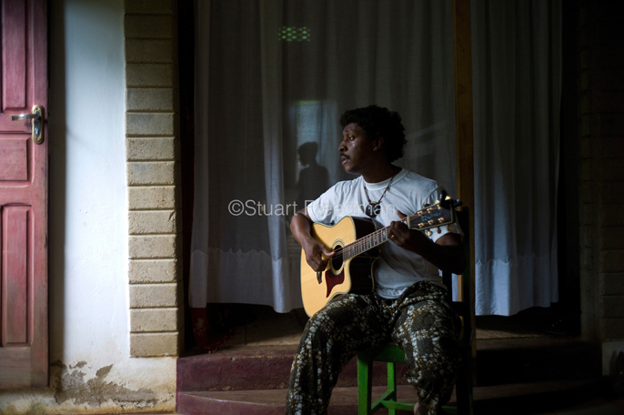 Sao Tome and Principe - Sao Tome - Singer Guilherme de Caravalho plays guitar at home