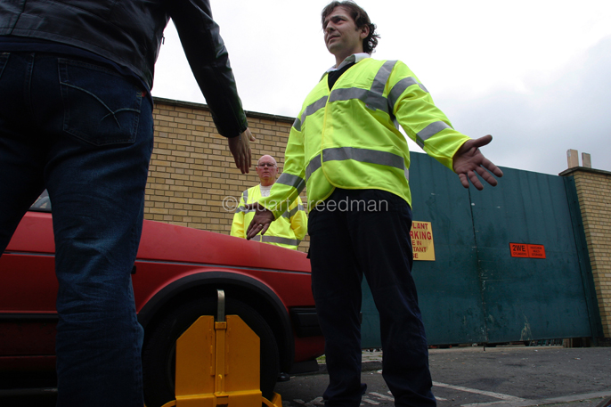 UK - London - An argument with a wheel clamper during a training exercise where clampers are taught to diffuse a potentially violent situation