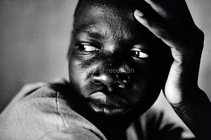"Uganda - Gulu - 'Andrew', 17. A former kidnapped fighter with the Lords Resistance Army, he remembers killing at least twelve. ""...but only two with a machete..."". Gulu, Uganda, ""We are the miracles that God made to taste the bitter fruits of Time..."" Ben Okri from 'An African Elegy'"