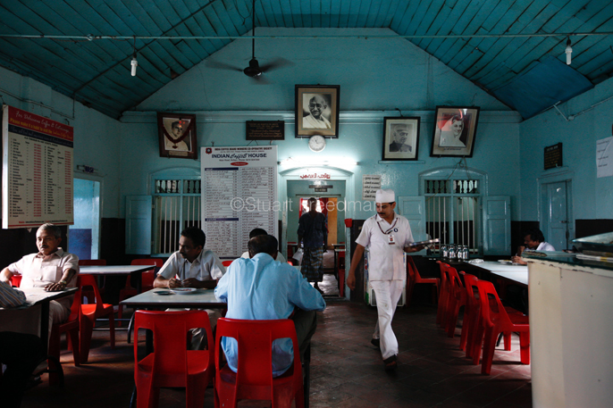 India - Kollom - A waiter walks through the Indian Coffee House